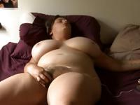 Amazing busty BBW masturbates on bed