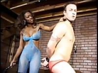 Nyomi Banxx spanks white submissive male and has him lick her boots