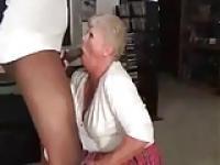 White granny makes a good fellatio to black cock