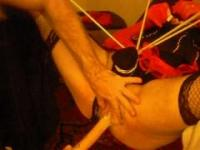 cross dresser gets fucked by cock and toys in sling !