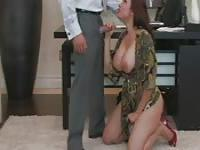Secretary kneels before her boss