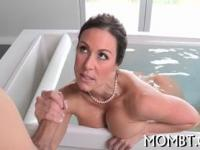 Busty brunette MILF loves the taste of a big meaty shaf