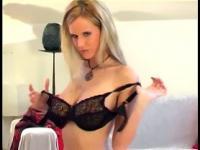 Glamour blonde lingerie tease in seamed stockings