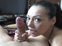 Latin girl squeezes two cocks