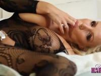 Dirty talking blonde babe with huge tits rubs pussy in sexy body stocking