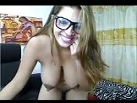 Busty woman with glasses on cam