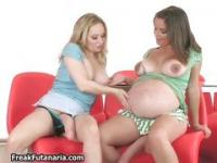 Pregnant brunette babe plays