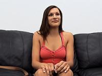 Expressive brunette models naked in front of camera