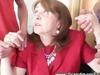 Old slut tugging cocks in the office