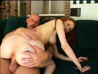 Delightful young redhead has two horny guys punishing her fiery holes