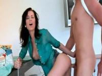 Sweet mom bent over the table and pounded