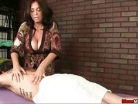 Horny Masseuse Can't Resist Stroking Her Clients Big Cock