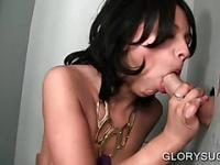 Aroused brunette sucking cock on gloryhole
