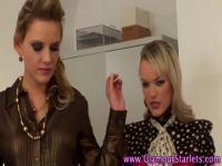 Clothed lesbians finger