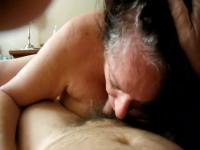 Lusty granny enjoys a big stiff cock in her mouth