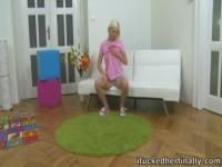 Sexy blonde Daryna sits lonely on her chair waiting for her friend to come over