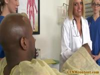 Clothed femdom doctors tugging black cock