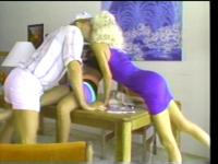 Horny slut gets her legs spread on the table and fucked by big cock