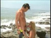 Blonde chick gets fucked doggystyle on the beach