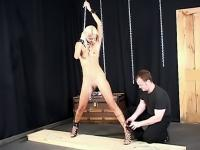 Guy playing with bound bitch's cunt