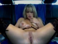 MILF diddles herself in a car