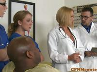 Doctors in uniform examin helpless black guy