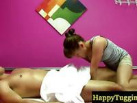 Sexy asian masseuse jerking client