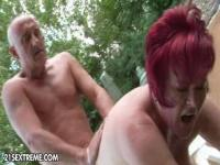 Old couple is having fun in the yard