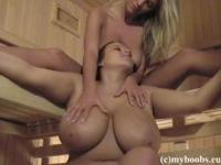 The natural ladies massage their huge tits in sauna