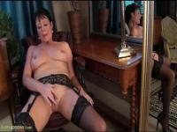MILF in stocking is fingering her pussy