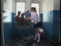 Fetish babe humiliates a chick in the prison