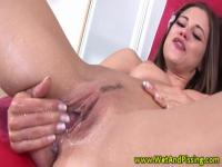 Brunette babe with huge tits is torturing her pink pussy