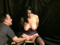Chubby brunette girl wearing a corset