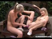Slender long legged babes on a park bench