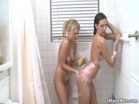 Beautiful girls taking a shower together