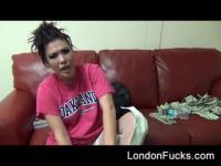 London Keyes on her phone after stripping