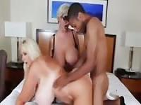 Two busty MILFs fucked by a young black man