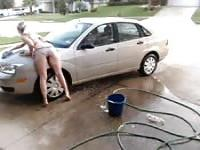Cam girl rubbing herself against her car