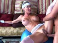 Busty blonde MILF working out hard with her fitness instructor