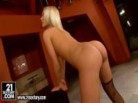 Hot blonde temptress Kittie stipps and masturbates on the huge music box
