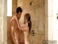 Slim beauty sucks hunk in shower