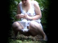 A menstruating woman pissing in the forest
