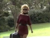 Queen Brings Surprise Suitcase