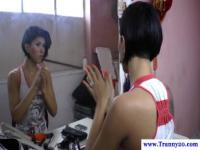 Tanlined ladyboy flashes her boobs