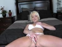 Smiling blonde shows her ass and masturbates