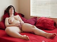 Recreational brunette lady masturbating