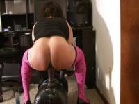 Tranny riding big black dildo