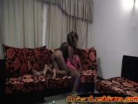 Ebony sluts pleasure each other with the same dildo