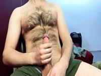 Hairy dude jacks on cam