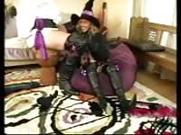 Woman in a witch costume sucks with scenserity